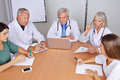 Team of doctors in a group meeting many talking Royalty Free Stock Photos