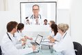 Team of doctors looking at projector screen Royalty Free Stock Photo