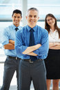 Team of executive with arms folded Royalty Free Stock Photos