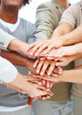 Team with hands stacked in unison Stock Photo