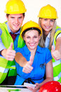 Team with hard hats looking at the camera Royalty Free Stock Photo