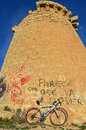Team merida bike a standing against an old stone lookout tower in santa pola during la vuelta españa Stock Photo