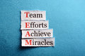 Team paper acronym in business concept words on cut hard light Stock Photo