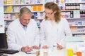 Team of pharmacist looking a medication for a prescription at hospital pharmacy Stock Photos