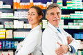 Team of pharmacists in pharmacy Royalty Free Stock Image