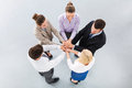 Team placing hands over each others high angle view Royalty Free Stock Photos