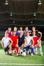 Team playing football or soccer sport indoor men and women in mixed Stock Photo