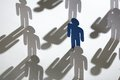 Team of similar paper men with a blue one Royalty Free Stock Images