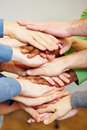 Team stacking many hands top each other motivation Stock Photos