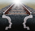 Team strategy on track business concept as a railroad in perspective with the shape of two human heads underground working Royalty Free Stock Image