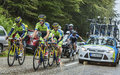 Team tinkoff saxo and alberto contador in pain col du platzerwasel france july members of the thinkoff help to climb the road to Royalty Free Stock Image