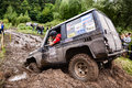 Team on Toyota LandCruiser Prado 70 using sand tracks. Royalty Free Stock Photo