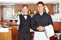 Team of waiter staff in restaurant with wine glasses a Royalty Free Stock Images