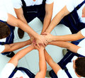 Team of workers joining hands in circle Stock Image