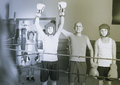 Team of young smiling boxer with coach standing