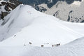 Teams of climbers in mountains near from mont blanc Stock Photos