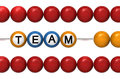 Teamwork as a metaphor abacus with text team concept Royalty Free Stock Photo