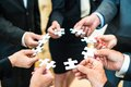 Teamwork - Business people solving a puzzle Royalty Free Stock Photo