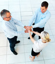 Teamwork - business team linking hands Royalty Free Stock Images