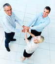 Teamwork - business team linking hands looking up Stock Image