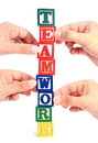 Teamwork closeup of many hands holding up letters to spell the work Royalty Free Stock Photo