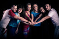 Teamwork concept.Fitness workout team motivation.Group of athletic healthy adults in gym giving group high five.United hands. Royalty Free Stock Photo