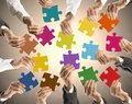Teamwork and integration concept of with businessman holding colorful puzzle Royalty Free Stock Images