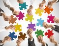Teamwork and integration concept of with businessman holding colorful puzzle Stock Photos
