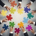 Teamwork and integration concept with puzzle pieces Royalty Free Stock Images