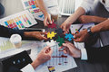 Teamwork of partners. Concept of integration and startup with puzzle pieces Royalty Free Stock Photo