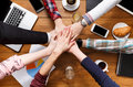 Teamwork and teambuilding concept in office, people connect hands Royalty Free Stock Photo