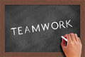 Teamwork text on blackboard handwritten chalk the Stock Photos