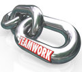 Teamwork word on chain links connected team partners the to illustrate partnership merger working together toward a common goal or Stock Photos