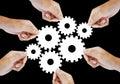 Teamwork works together to build a cog wheel gear system.