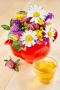 Teapot with bouquet of healing herbs and flowers Stock Photography