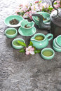 Teapot and cups on stone table. Asia style stil life Royalty Free Stock Photo