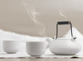 Teapot and cups on table Royalty Free Stock Photo