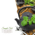 Teapot with fresh herbs green cups and copy space Stock Photos