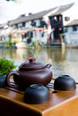 The teapot in front of Chinese house Stock Image