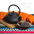 Teapot and glass cup of tea on a colorful striped background Royalty Free Stock Photo