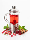 Teapot with tea glass hot berries on a white background Royalty Free Stock Image
