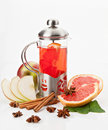 Teapot with tea glass hot slices of grapefruit and apples and cinnamon on a white background Royalty Free Stock Image