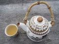 Teapot and teacup close up Stock Image