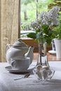 Teapot teacup and lilacs sweets white lilac in a glass vase Stock Image