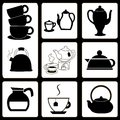 Teapots and cups set Stock Photos