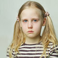 Tears little girl with sad expression and Stock Photo