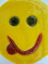 Teasing smile for good mood sweets candy lollipop yellow Royalty Free Stock Photos