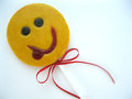 Teasing yellow smile for good mood sweet candy lollipop white background Stock Photo