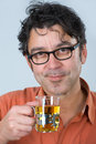 Teatime man with dark hair and glasses is drinking tea Stock Images