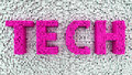 Tech on a background of cubes in uppercase transparent magenta letters three dimensional white scattered in random pattern Stock Image